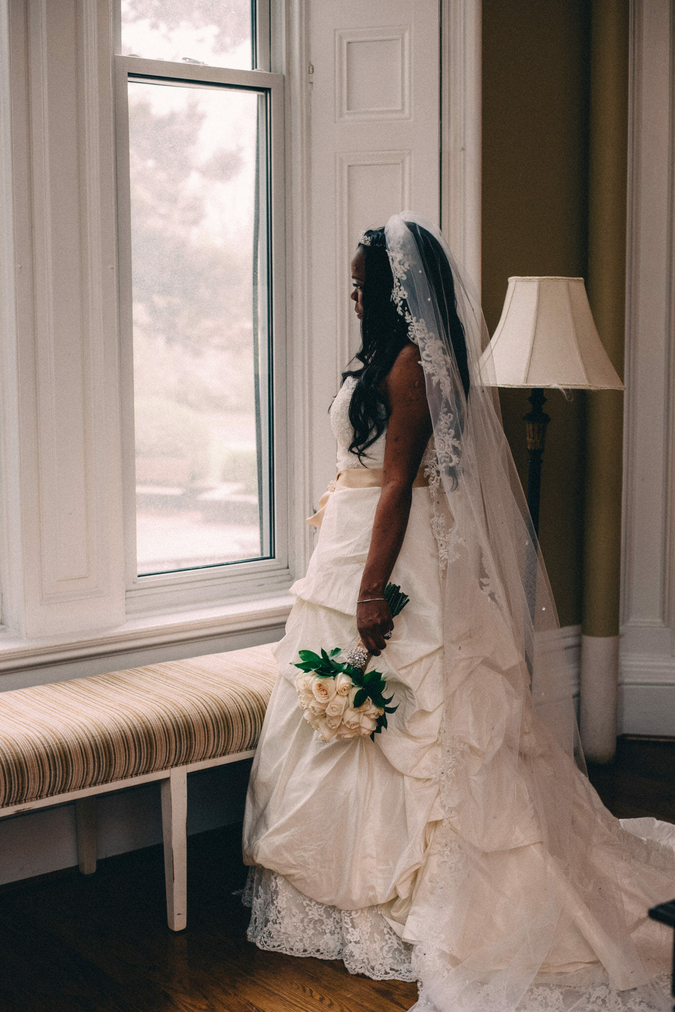 bride looking out window at trafalgar castle