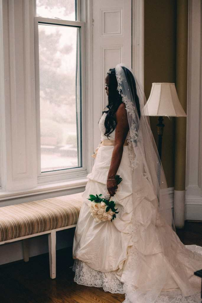 bride looking out window at trafalgar castle