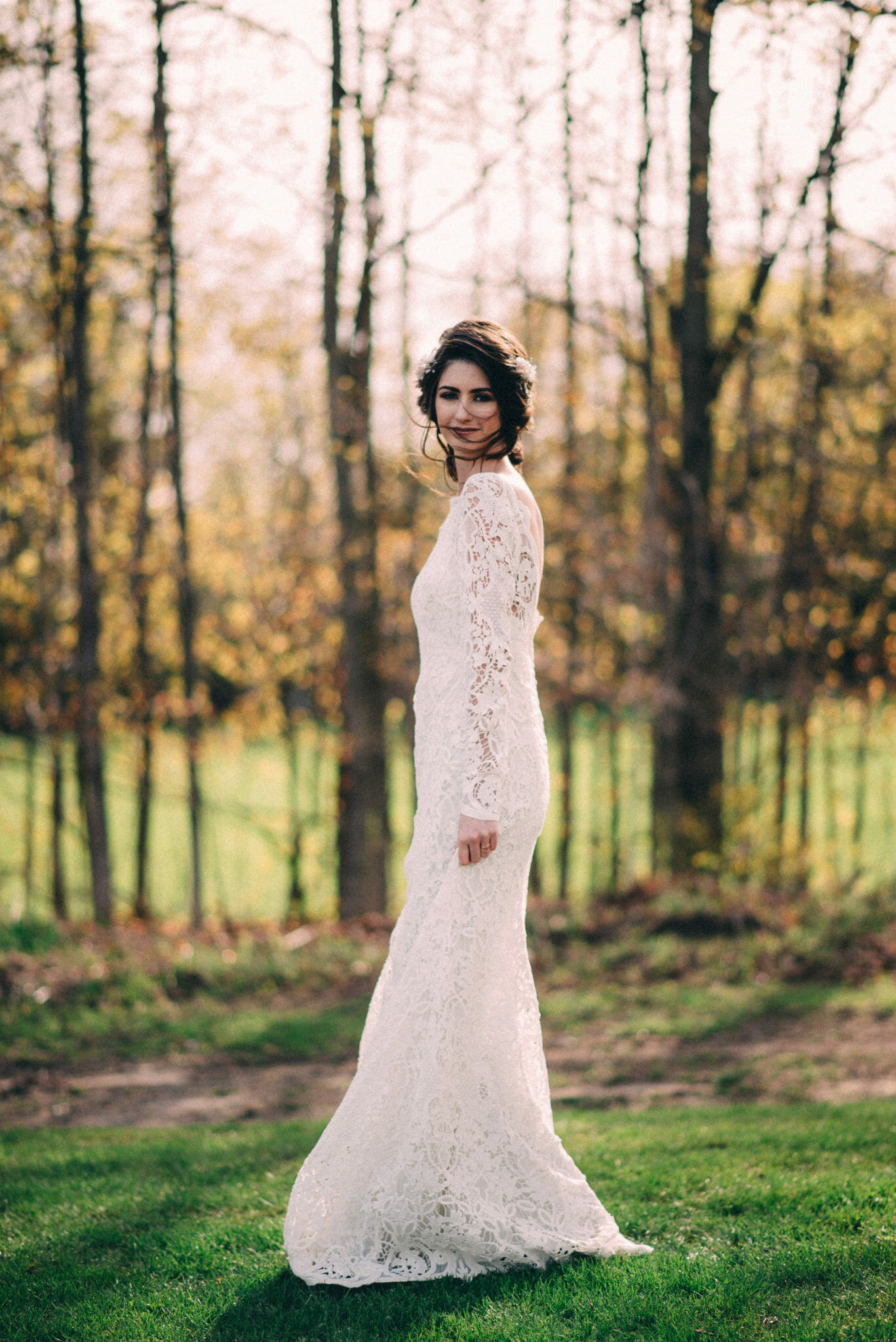 bride twirling in white lace gown
