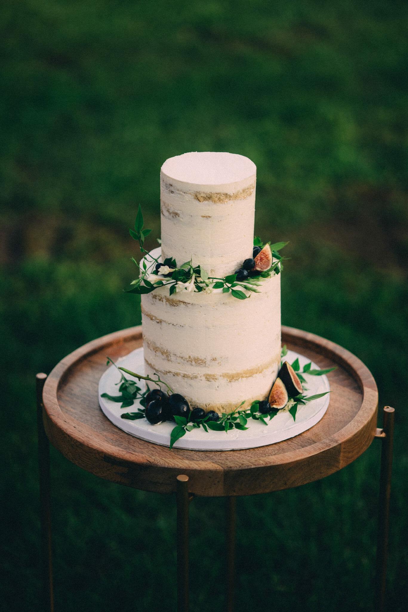 bohemian naked cake with greenery