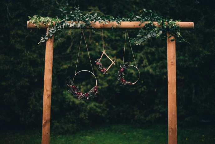 wedding arbour with greenery and wreaths