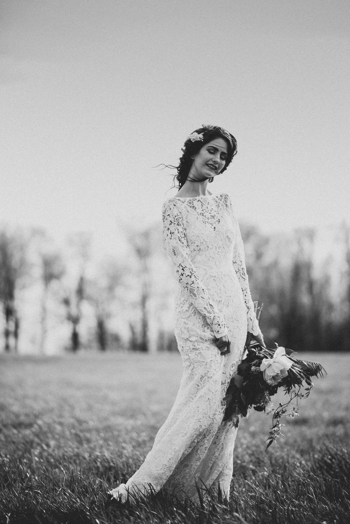 bohemian bride twirling in field