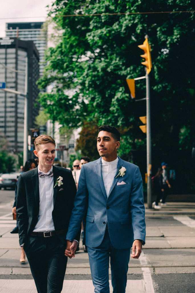 married couple walk on toronto city street