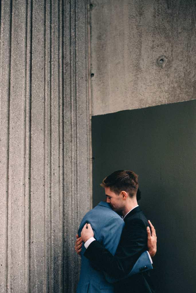 couple hug in front of toronto sheraton hotel
