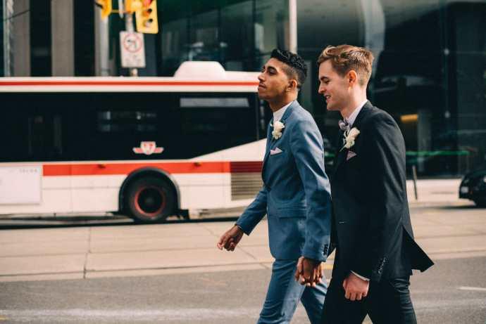 gay couple walking on toronto city streets