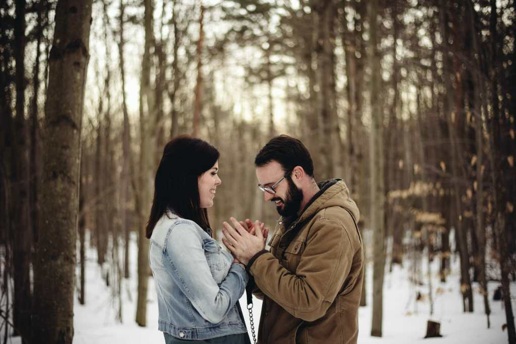 couple trys to stay warm during winter hike