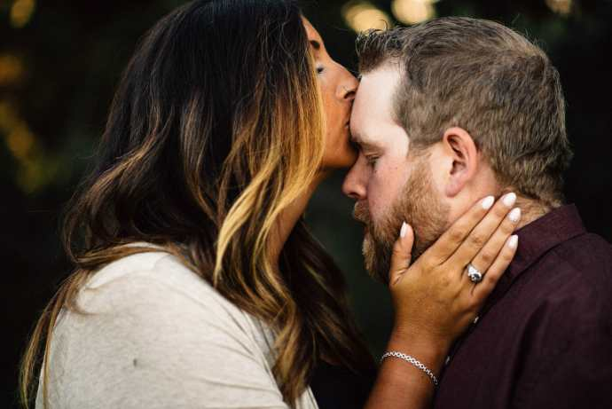 fiancee kisses fiances forehead