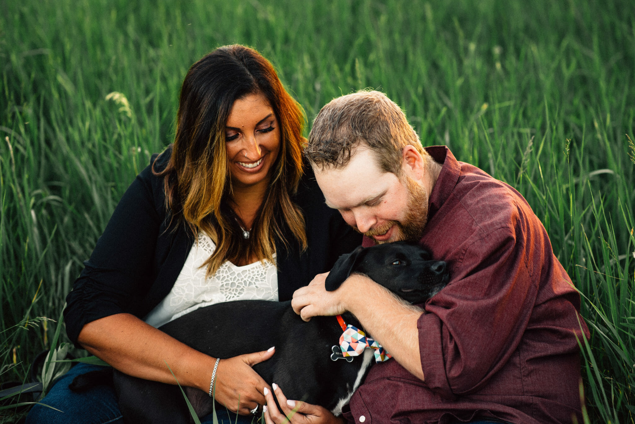 engaged couple snuggle their dog during bowmanville engagement session