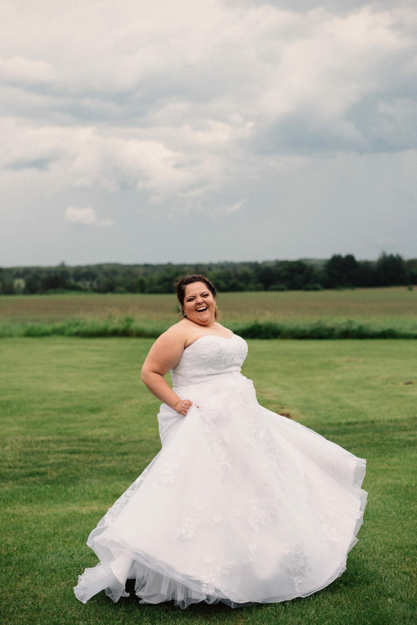 bride dancing in dress at herongate barn theatre