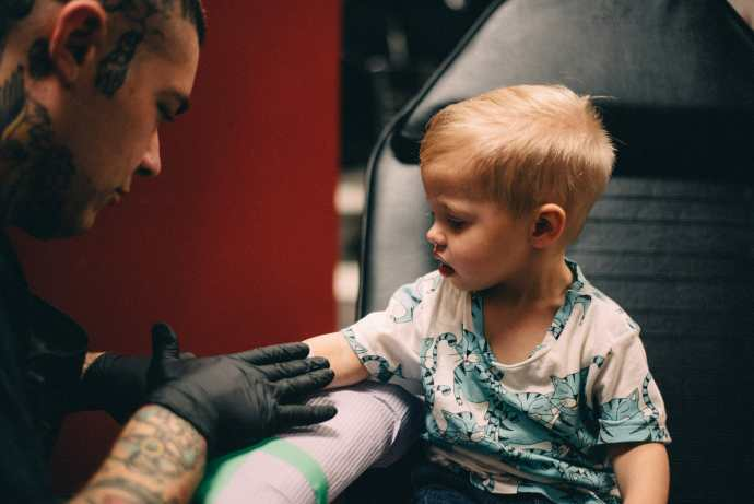little boy gets stencil tattoo at taunton tattoo co oshawa