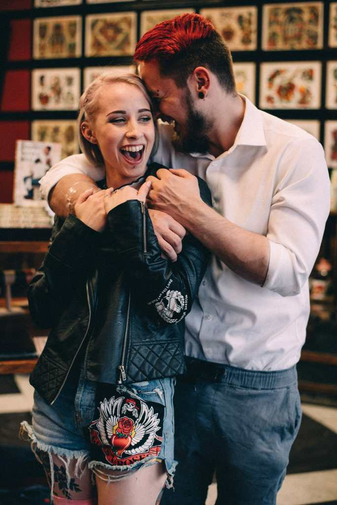 engaged couple laugh in taunton tattoo oshawa