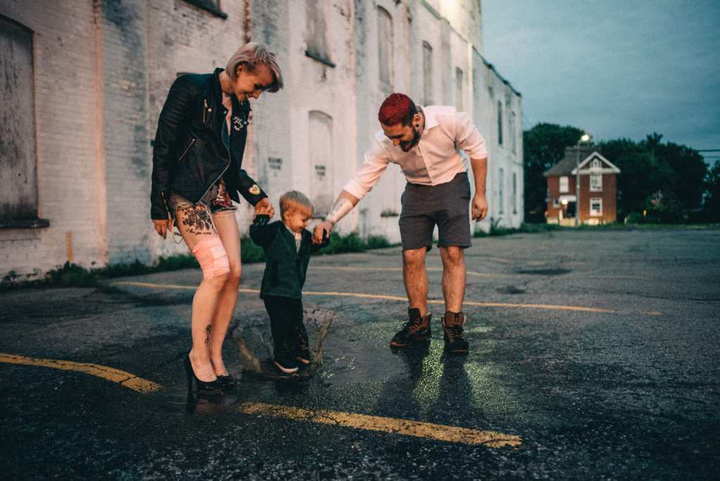 couple plays in puddle during engagement session downtown