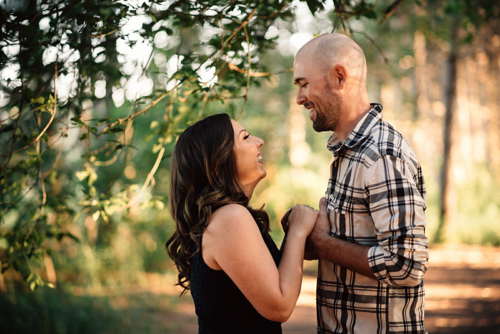 fiancees laugh together during photoshoot