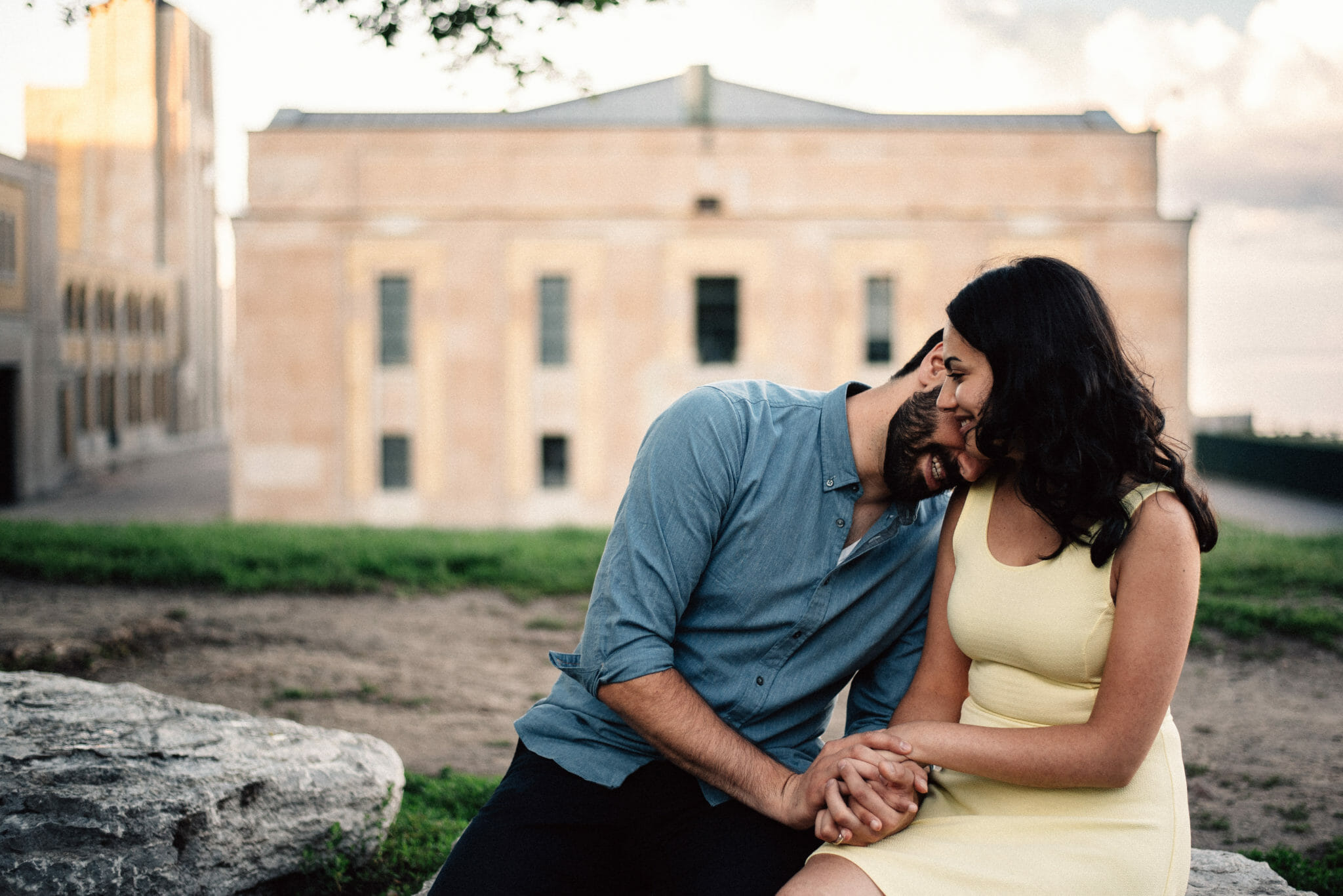 engaged couple cuddle during photo session at rc harris