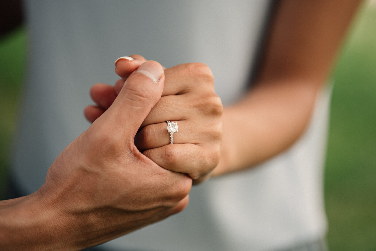 newly engaged couple shows off diamond engagement ring