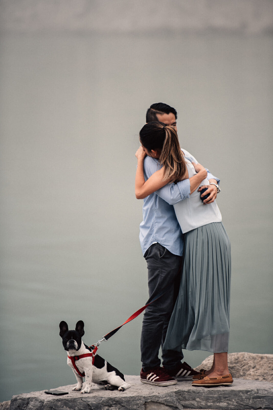 couple hug after getting engaged at the scarborough bluffs toronto