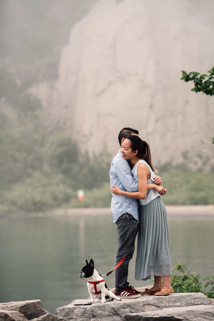 couple hugs after getting engaged at scarborough bluffs in toronto