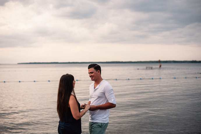 married couple talk during photoshoot on lake simcoe