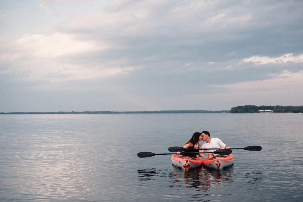 married couple kayaks on lake simcoe