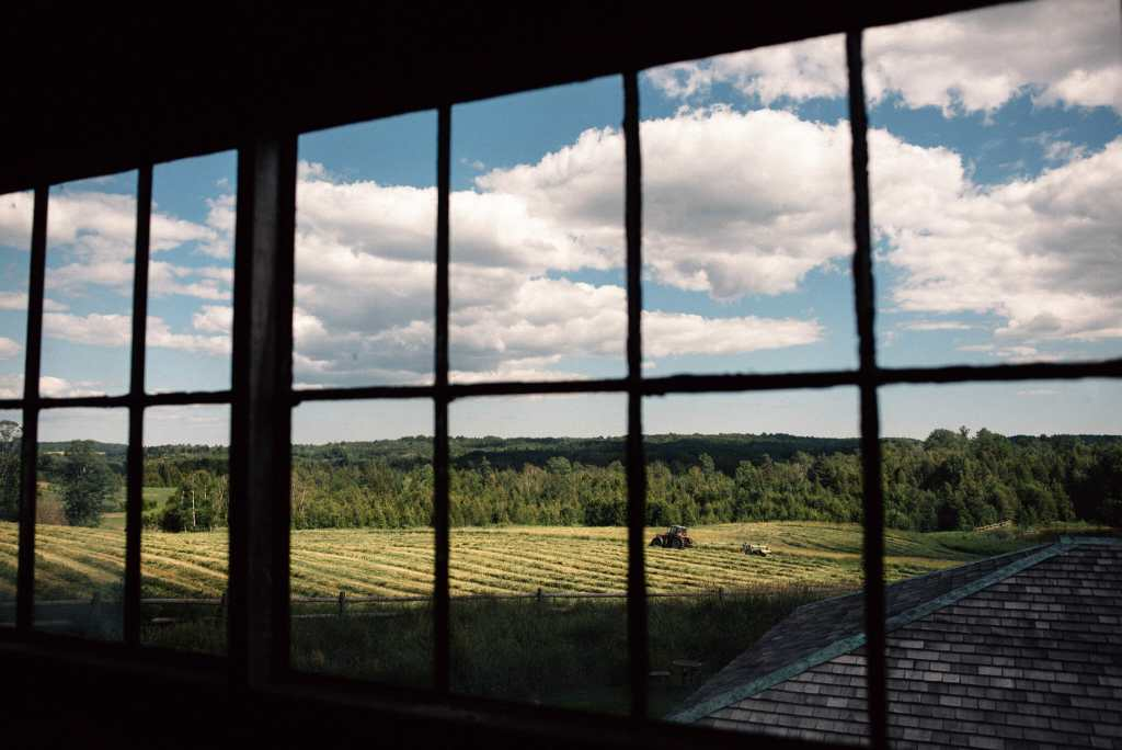 view from inside century barn over looking farmers fields