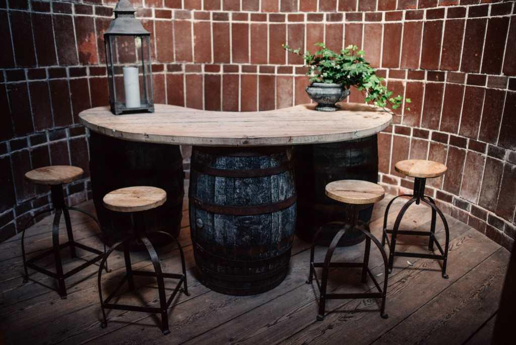 bar and stools inside restored barn silo