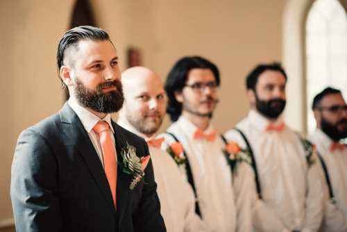 groom watches as his bride walks down the aisle