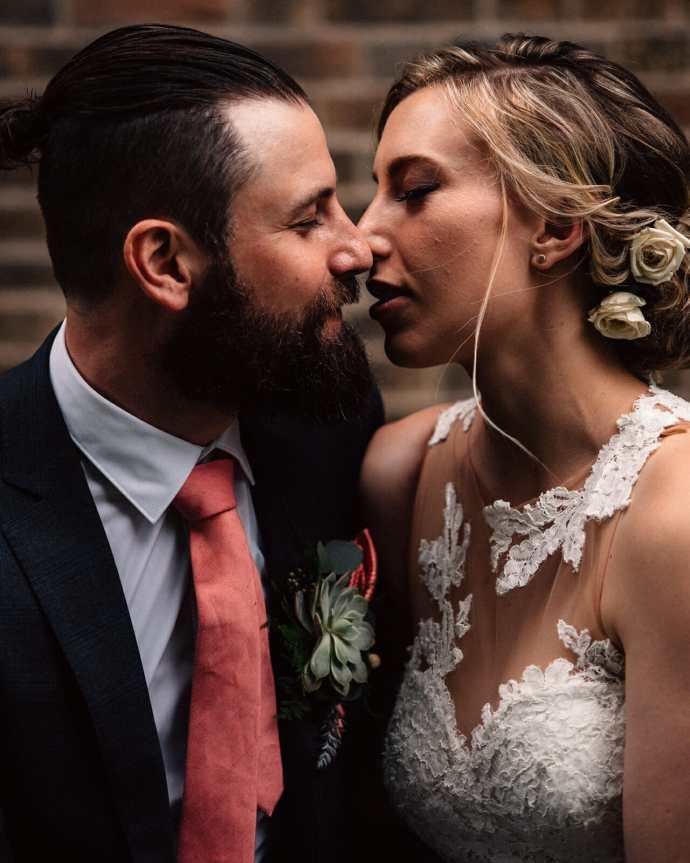bride and groom go in for a kiss