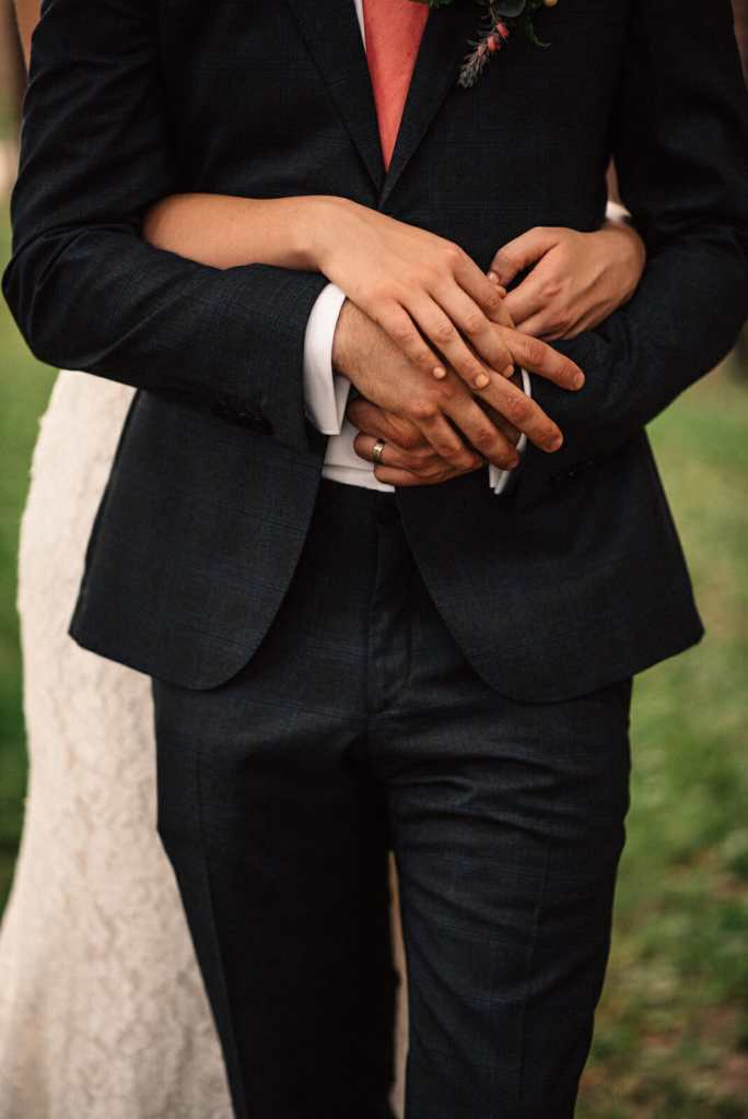 newlyweds hold hands after toronto wedding ceremony