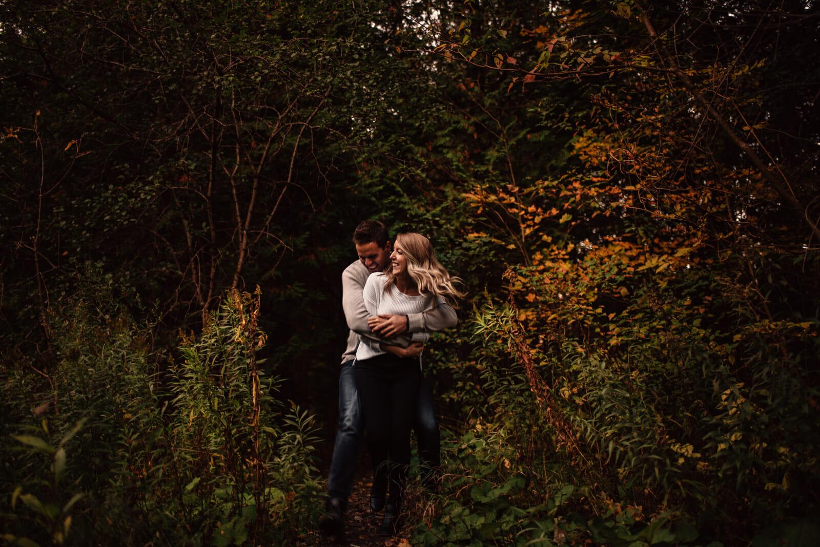 toronto couple runs around under fall trees