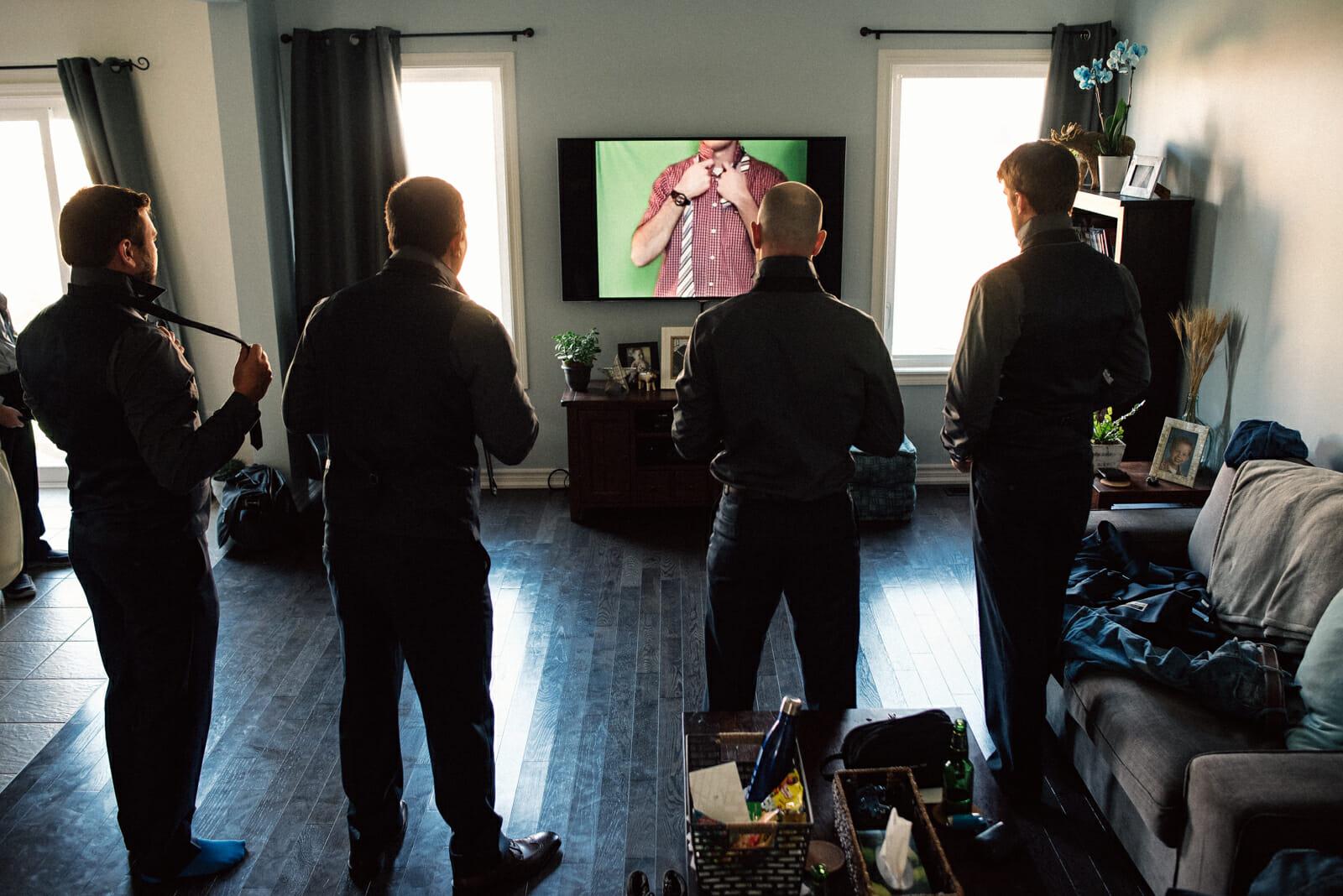 groomsmen watch youtube how to tie