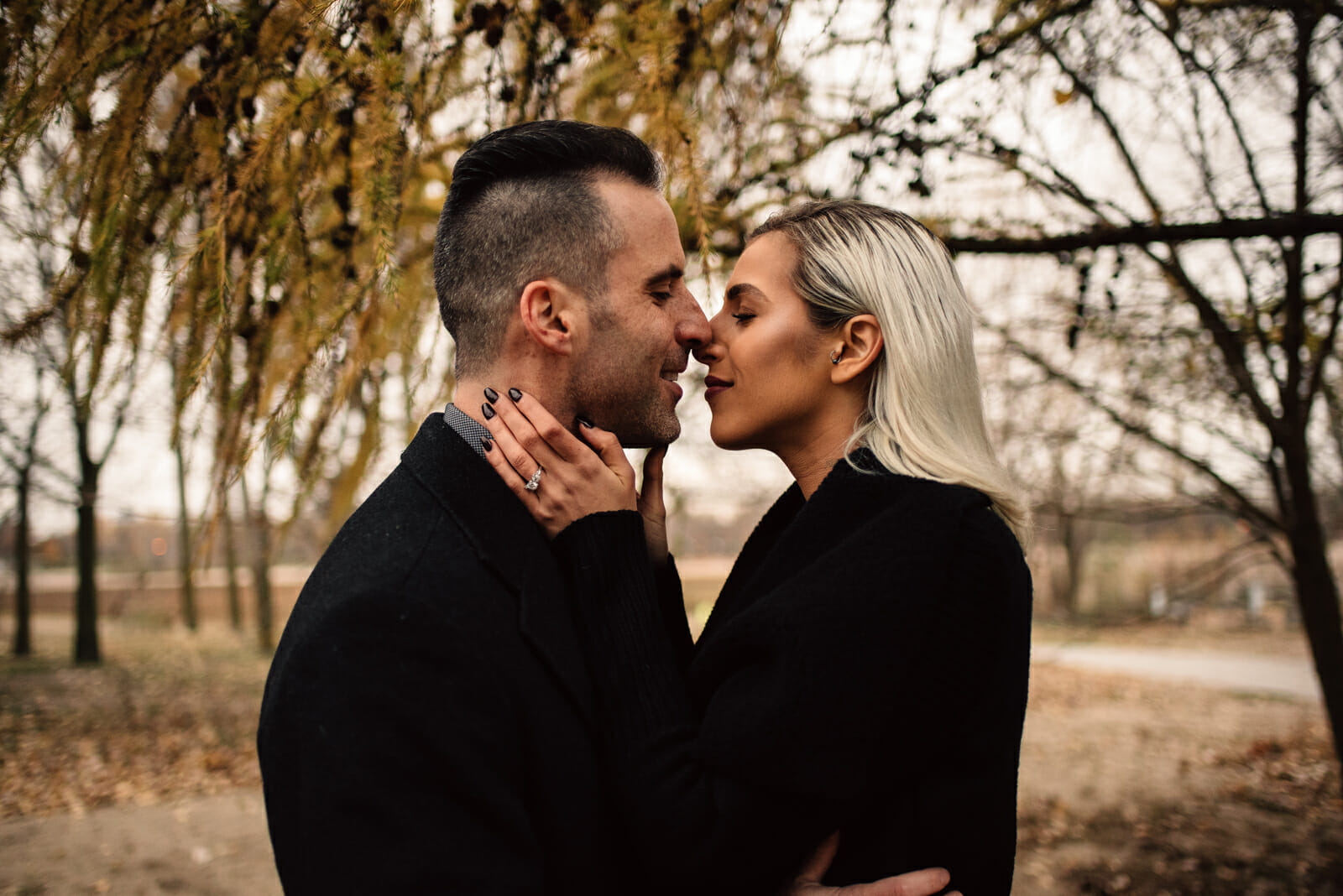 romantic moment between fiances at engagement session