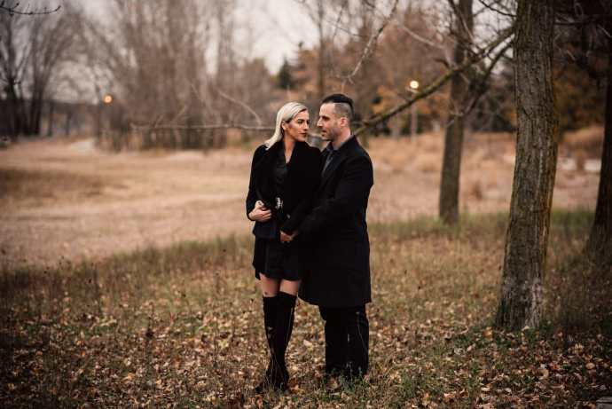 engaged couple embraces during photoshoot