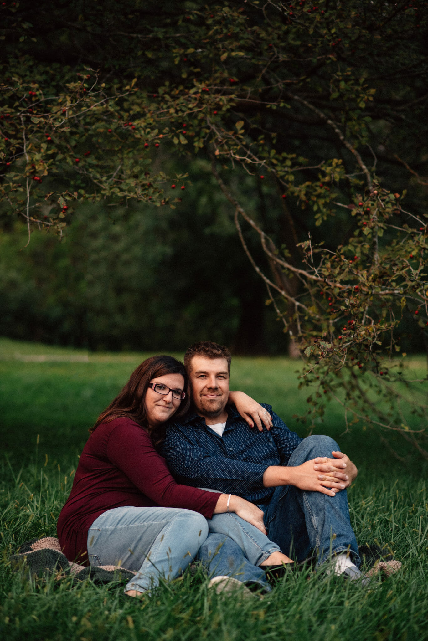 engaged couple embraces in local whitby ontario park