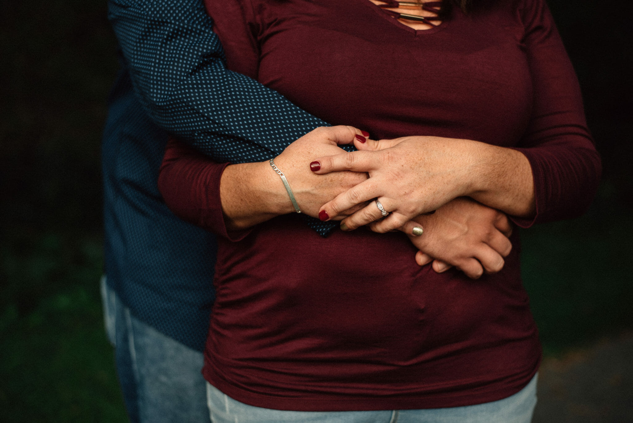 engaged couples hands together