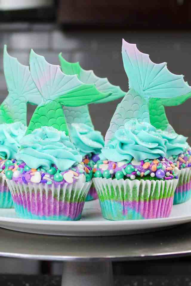 Mermaid Tail Cupcakes, made with fancy sprinkles and fondant tails
