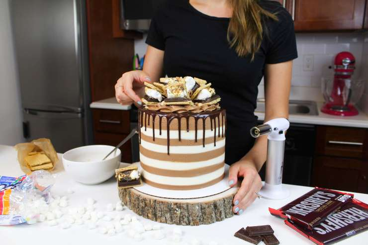 me placing smores on cake