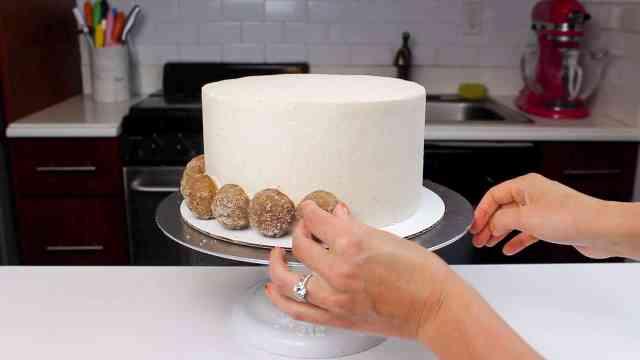 adding donut holes to base of ACD cake-2