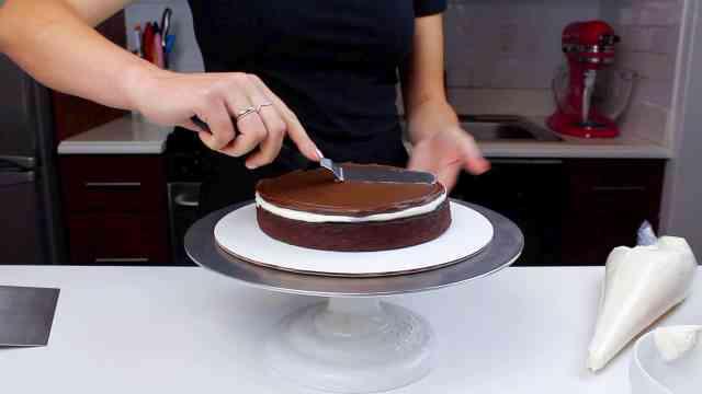 spreading ganache onto hot cocoa cake-2