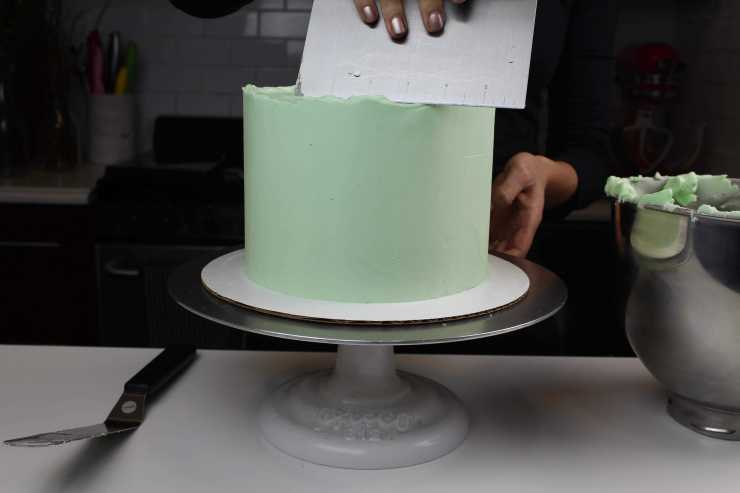 smoothing second light green frosting