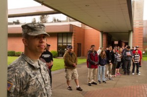 Sargent Reno and Chemeketa student and staff listen to Maj. Paul Evans' Memorial Day address.