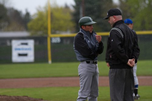 Coach Nathan Pratt expresses his opinion on an interference call to the first-base umpire during the Storm's second-game victory against  the Clark College Penguins on April 11.