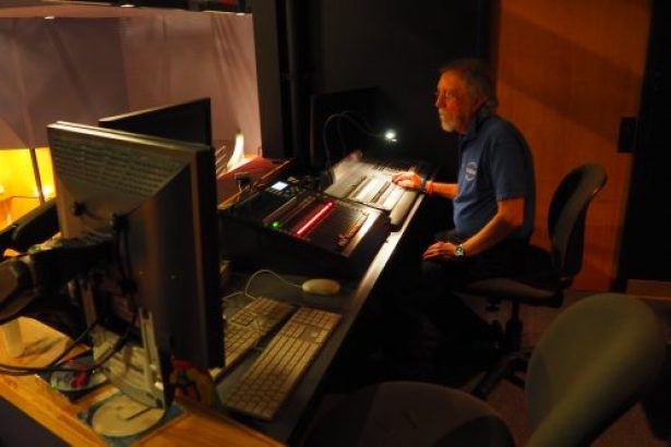 Auditorium coordinator Terry Rohse working in the control booth