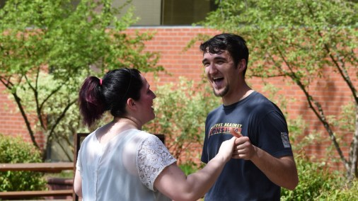 A pair of students enjoy a dance near the Ballroom Dance Club booth. Photo by Dylan Umsted.