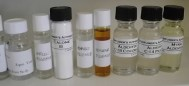 Essences, from the left is neroli, mango, banana, coconut (C-18 aldehyde) and peach (C-14 aldehyde). Second from the left is Calone powder