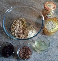 The ingredients: chopped nuts, dried cranberries, raisins, seeds, oat bran, egg whites and honey