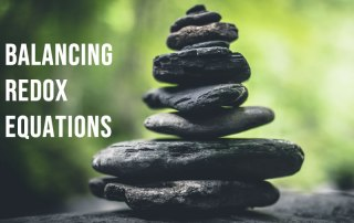 Rocks balanced on top of each other to represent balancing chemical equations