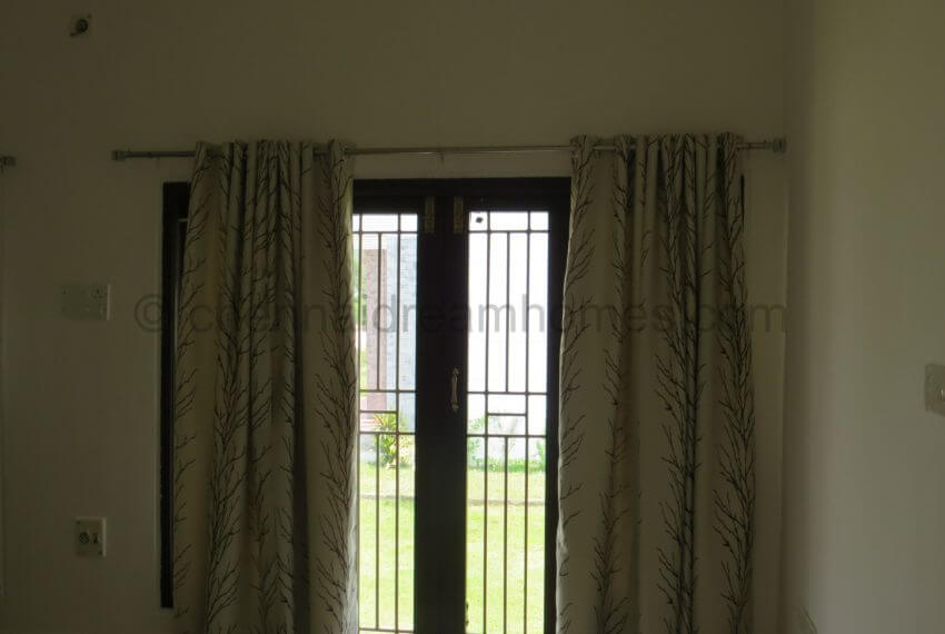 French window + furnishing  leading to the garden
