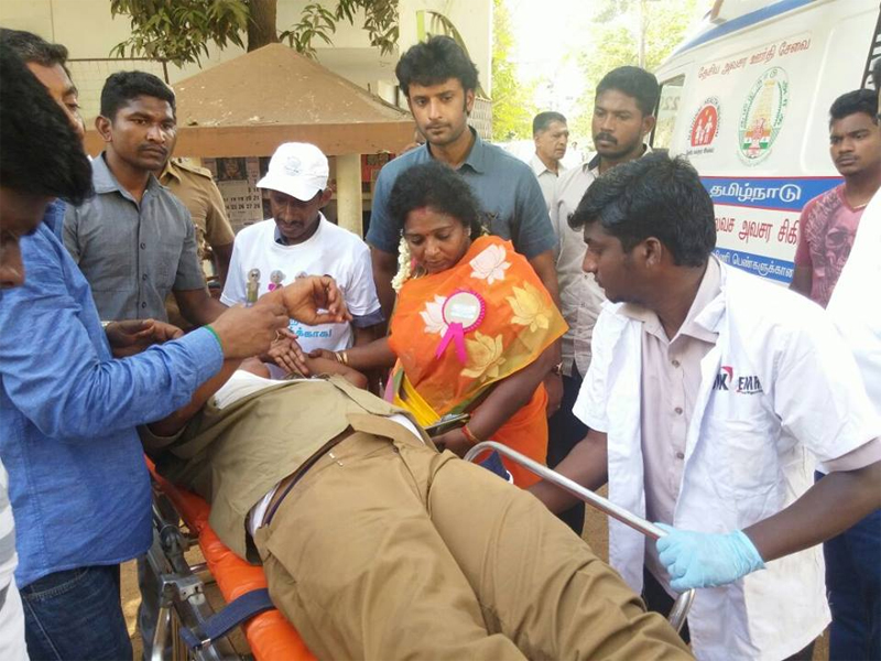 Tamilisai performs first-aid to fainted cop at polling booth