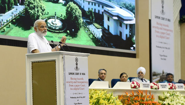 Modi attends event to mark introduction of digital filing as a step towards paperless SC