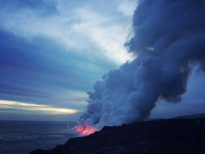 View at dusk at the Kalapana Flow area, where lava is flowing into the sea.